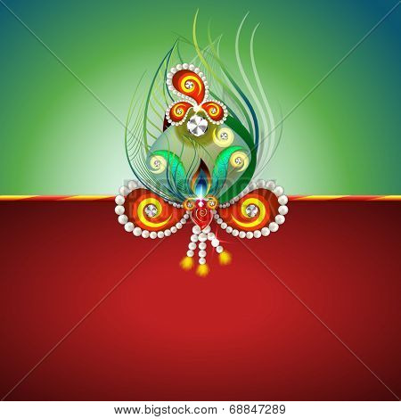 Beautiful peacock feather and pearls decorated rakhi on green and red background for Raksha Bandhan celebrations.