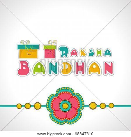 Beautiful rakhi with colorful gift boxes on grey background for Raksha Bandhan celebrations.
