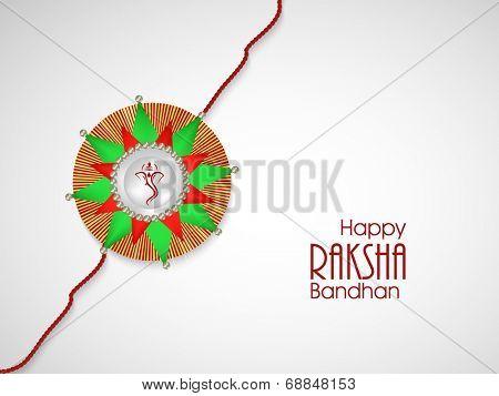 Beautiful rakhi decorated with mangoes leaves on grey background for the occasion of Raksha Bandhan celebrations.