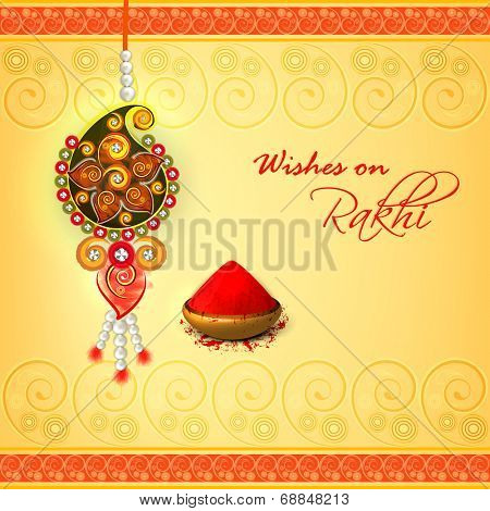 Beautiful pearls decorated rakhi on floral decorated yellow background for Raksha Bandhan celebrations.