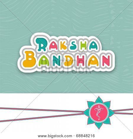 Beautiful rakhi decorated by Hindu mythology lord Ganesha face for the occasion of Raksha Bandhan festival celebrations.