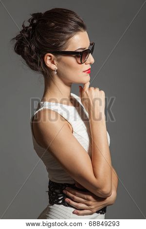Portrait Of Brunette Beautiful Girl Posing In White Dress