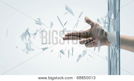 Close up of male hand breaking glass with finger