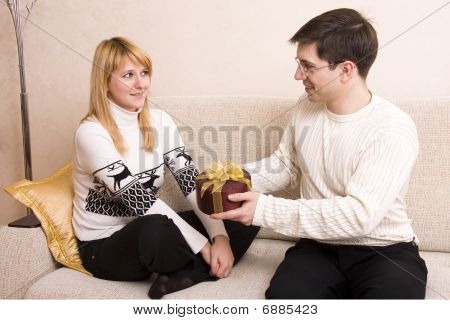 Man Is Giving Gifts Woman At Valentine Day.