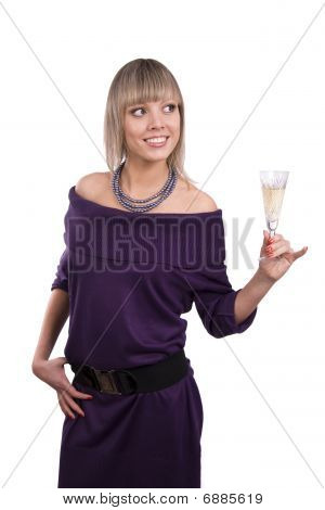 Woman Is Holding A Glass Of Champagne