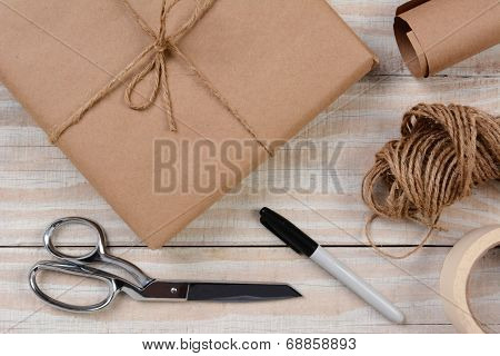 High angle shot of the tools and materials for wrapping a parcel.