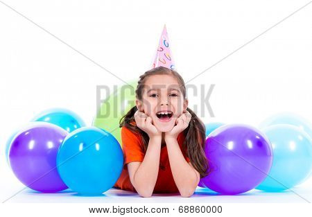 Happy smiling girl in orange t-shirt  lying on the floor with colorful balloons - isolated on a white.