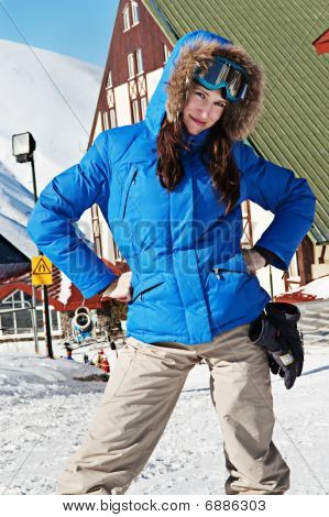 Smiley Skier With Hotel At Background