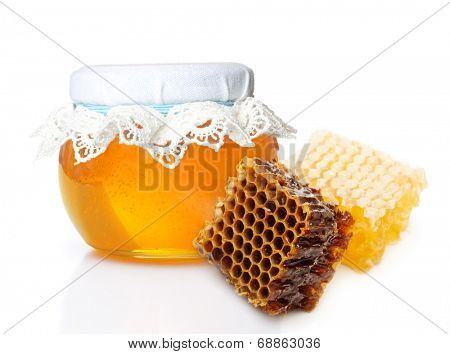 Glass bowl with honey and slice honey comb isolated on white background