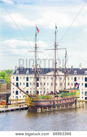 View of a rebuilt Indiaman ship and the Maritime museum in the Amsterdam Harbour