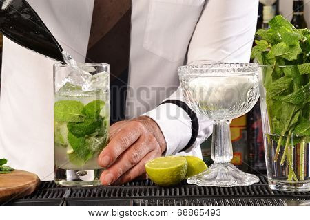 Barman preparing cocktail.Bartender preparing cocktail.