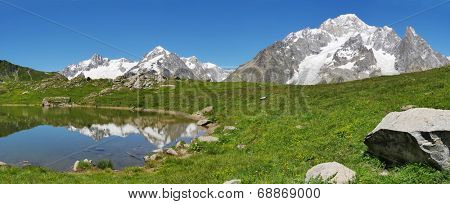 The south face of Mont Blanc (italian side), from the Vesses lake in Val Veny valley along the famous Tour du Mont Blanc trail. Courmayer, Valle d'Aosta, Italy.