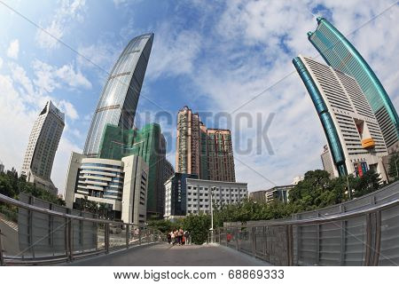 SHENZHEN -  CITY IN SOUTH OF  PEOPLE'S REPUBLIC OF CHINA - NOVEMBER 19, 2011: The magnificent modern city with wide prospectuses and skyscrapers.Pedestrian bridge in the city center