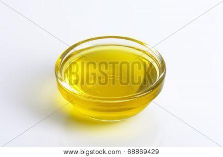 bowl of fresh olive oil on white background