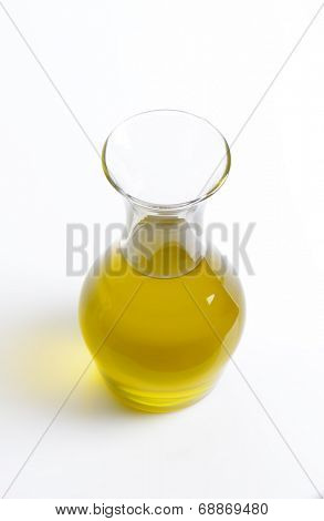 carafe of fresh olive oil on white background