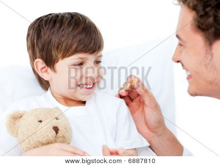 Enthusiastic Doctor Taking Little Boy's Temperature