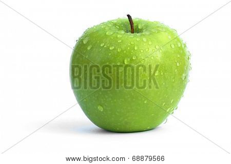 fresh green apple with waterdrops isolated on white.