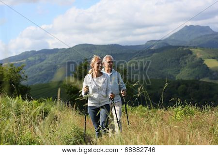 Senior people hiking in beautiful natural landscape