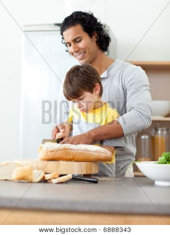 Charming Father Cutting Bread With His Son