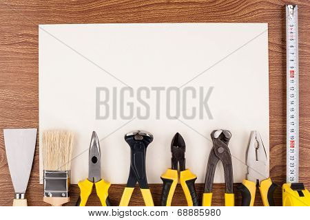 Work tools and sheet of paper.