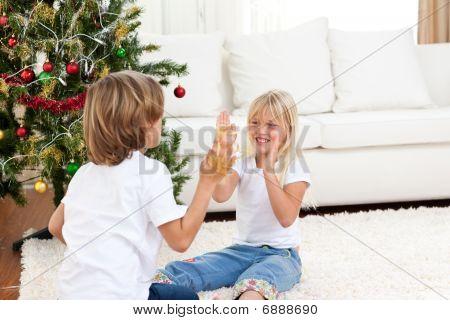 Cute Siblings Having Fun At Christmas