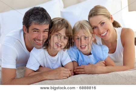 Merry Family Having Fun In The Bedroom