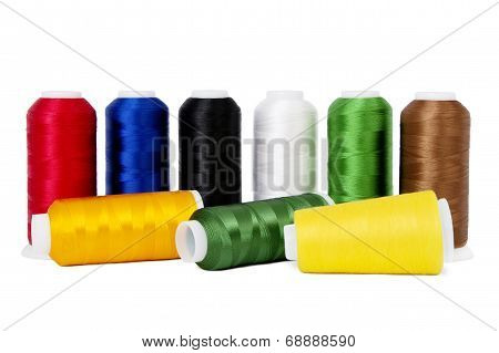 Multiple Reels of Floss Sewing Thread in Various Colours Grouped Together, Isolated on White Backgro