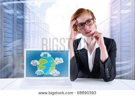 Thinking redhead businesswoman against server hallway in the sky