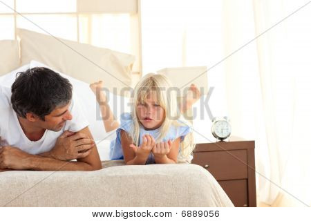 Adorable Child Having Discussion With Her Father