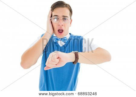 Geeky young hipster realising hes late on white background