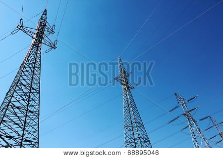 Big High Voltage Electric Towers Under Blue Sky