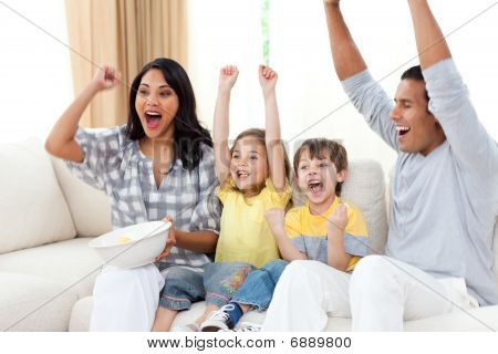 Animated Family Watching Tv On Sofa