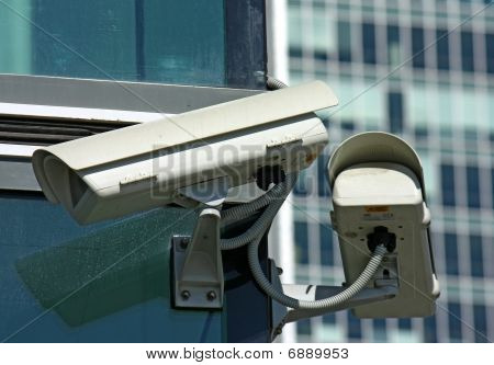 two surveillance cameras and glass