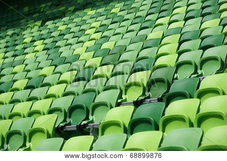 Empty bleachers at stadium. Green empty  tribune