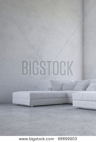 Minimalist living room interior with an upholstered corner suite against a double volume bare mottled grey wall in an architectural background