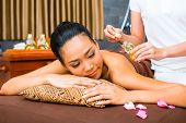 pic of half naked  - Beautiful Asian woman receiving massage - JPG