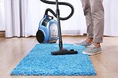 stock photo of cleanliness  - Man doing vacuum cleaning in room - JPG