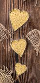 foto of millet  - Portion of Millet on dark wooden background  - JPG
