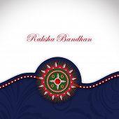 pic of rakhi  - Beautiful Rakhi on grey and blue background on the occasion of Raksha Bandhan festival - JPG