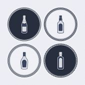 image of whiskey  - 4 alcohol bottles icons shows off different bottles shapes like a vodka and a beer. Pictured here from left to right - 