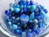 Blue Beads In A Glass Bowl