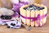 picture of cream cake  - Tasty cake Charlotte with blueberries on wooden table - JPG