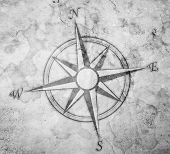 stock photo of cartographer  - vintage compass on old paper with stains - JPG