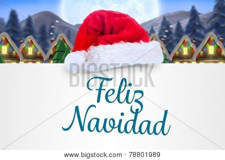 Feliz navidad against quaint town with bright moon