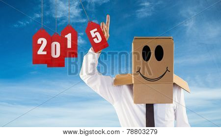Anonymous businessman with hand pointing up against blue sky