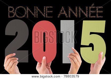 Hands holding poster against glittering bonne annee
