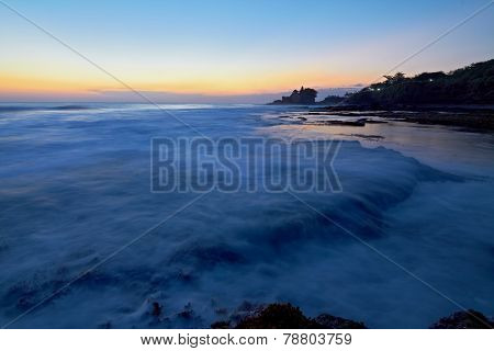 Tanah Lott Temple And Ocean Waves At Sunset