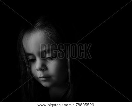 Low Key Portrait Of A Young Child