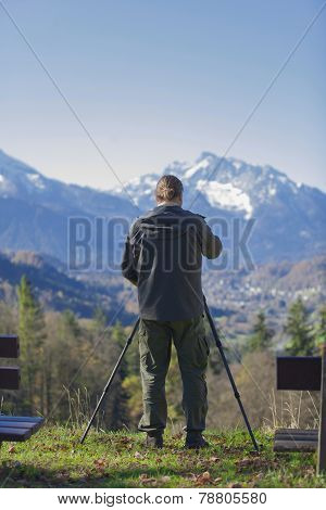 Photgrapher Is Taking Pictures Of A Mountain