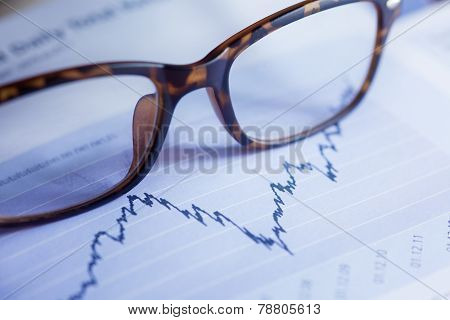 Glasses Are Laying On Ashare Index